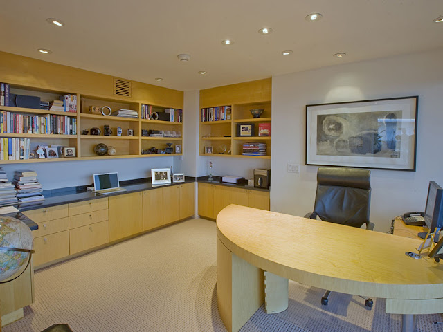 Picture of nice small home office with light wooden furniture