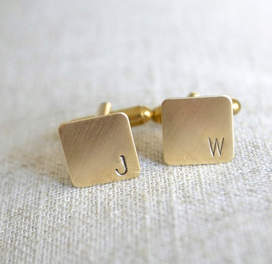 http://www.whitetrufflestudio.com/collections/stamped-metal-cufflinks/products/personalized-initial-mini-cufflinks-hand-stamped-in-brass