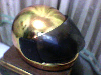 helem cat emas sistem tempel prada