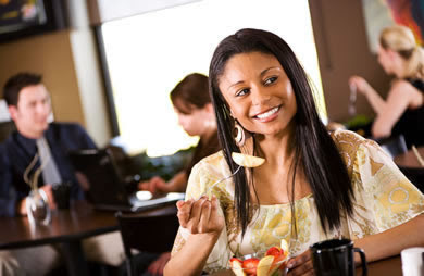 African American Woman Eating Out