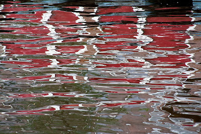reflection of red living boat