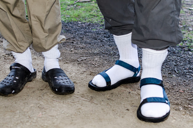 teva sandals and croc shoes with knee high white socks