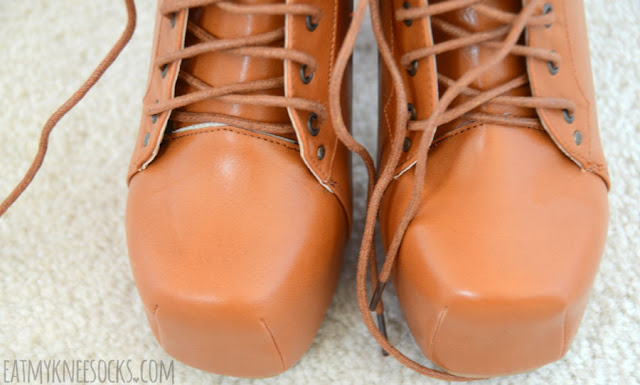 Close-up of the lace-up front on the faux-leather tan platform booties from Milanoo.