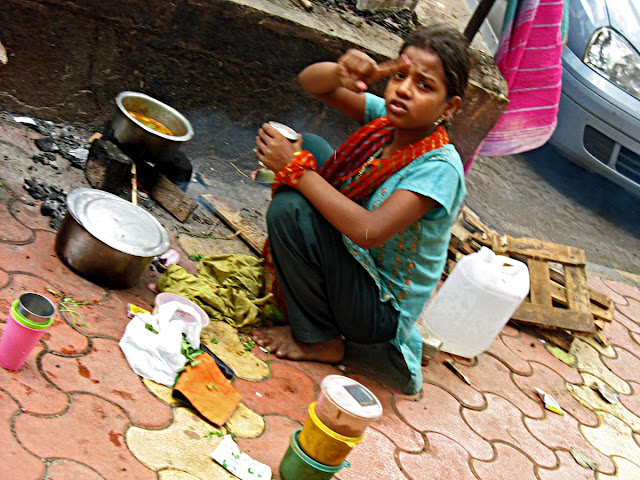 girl cooking on pavement