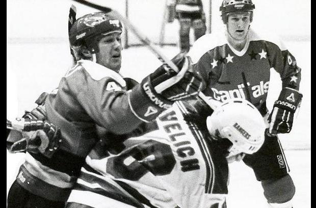 Randy Holt, trying to wedge his stick through Matt Pavelich's helmet.