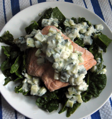 poached salmon with cilantro tzatziki and spinach salad