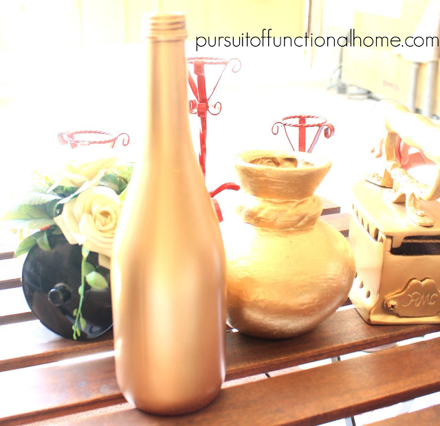 Treasure Hunting by Pursuitoffunctionalhome.com. Wine Bottle, iron and vase were paint in gold
