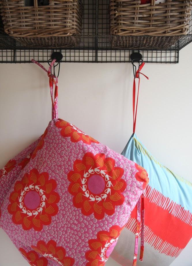 ikea cushions with a red and pink floral motif