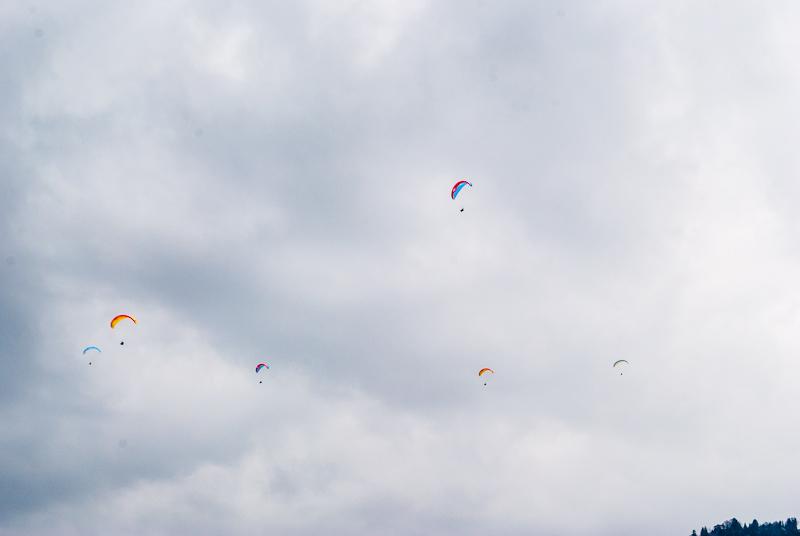 Paragliders gliding in the sky in interlaken Switzerland.