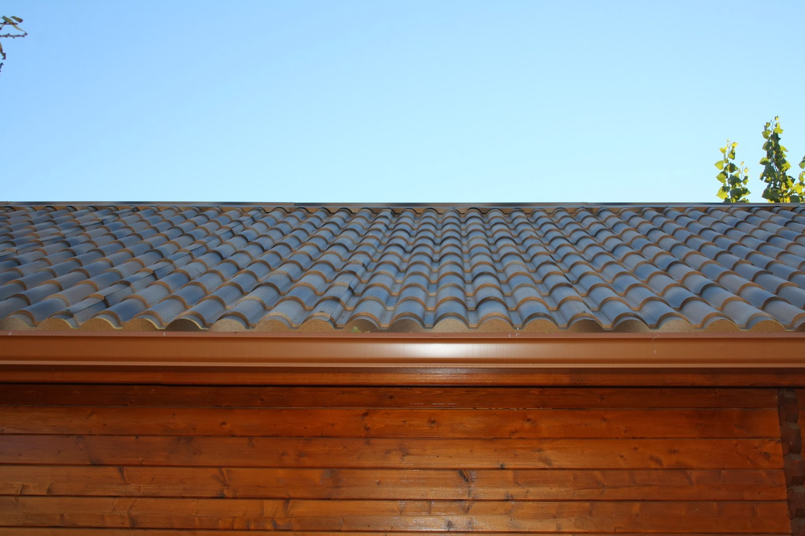 Cambiar tejado viejo en una casa de madera instaladores for Tejados de madera con teja