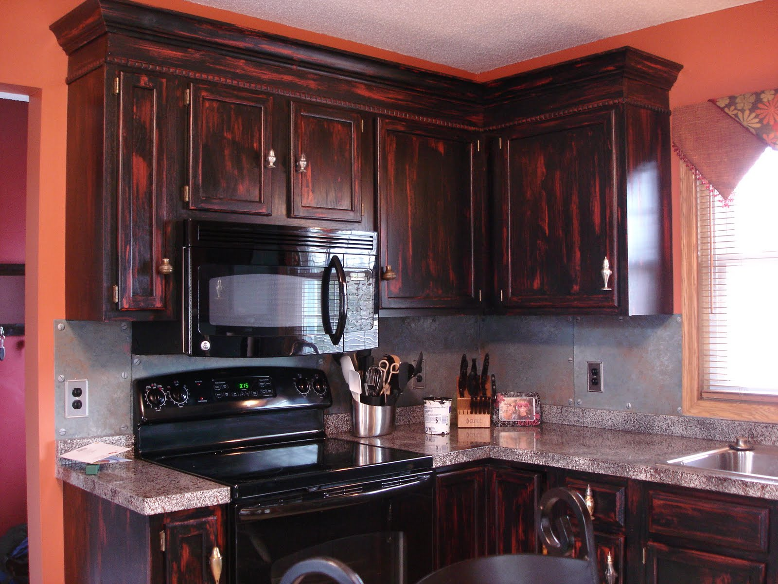 Emberrubbed cabinets with stacked crown moulding.