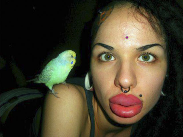 Woman with the world's biggest lips:Kristina Rei