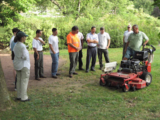 Tim Downey, owner of Aesthetic Landscape Care, consults with Greenburgh DPW