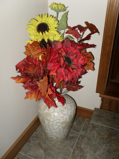Flower arrangement made with leaves and flowers from Hobby Lobby.