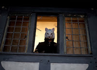 Fox mask in window in You're Next