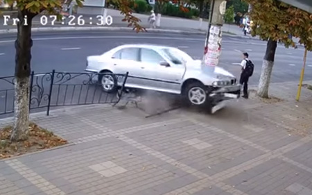Boy steps aside seconds before car slams into same place