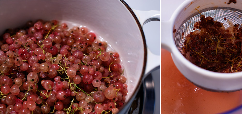 small pink currant berries being cooked in a white pot