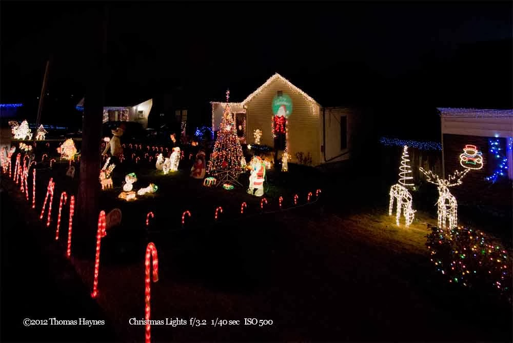 House with christmas lights adorning home and yard, many candy canes