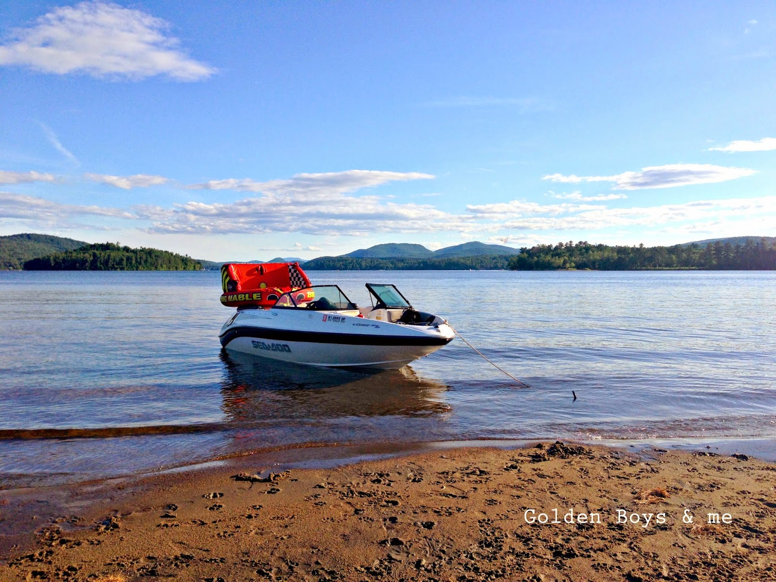 Sea Doo jet boat with Big Mable towable on Schroon Lake in NY-www.goldenboysandme.com