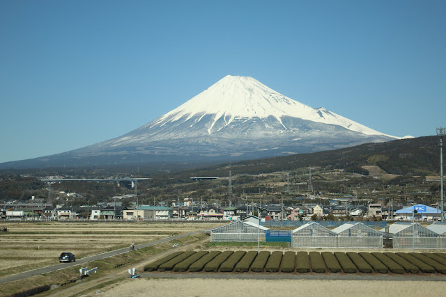 The view of Mount Fuji during the Shinkasen train ride (bullet train from Tokyo to Osaka) in Japan
