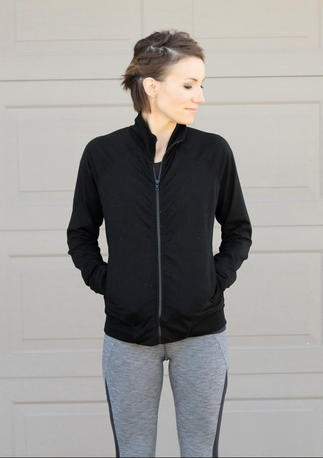 Black running jacket, gray running pants