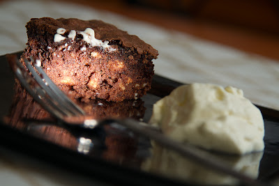 A brownie lit only by a grid spot