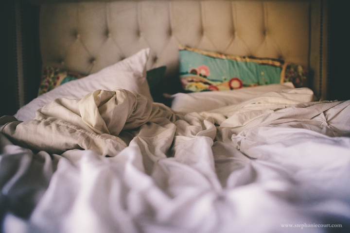 """unmade bed in morning light"""