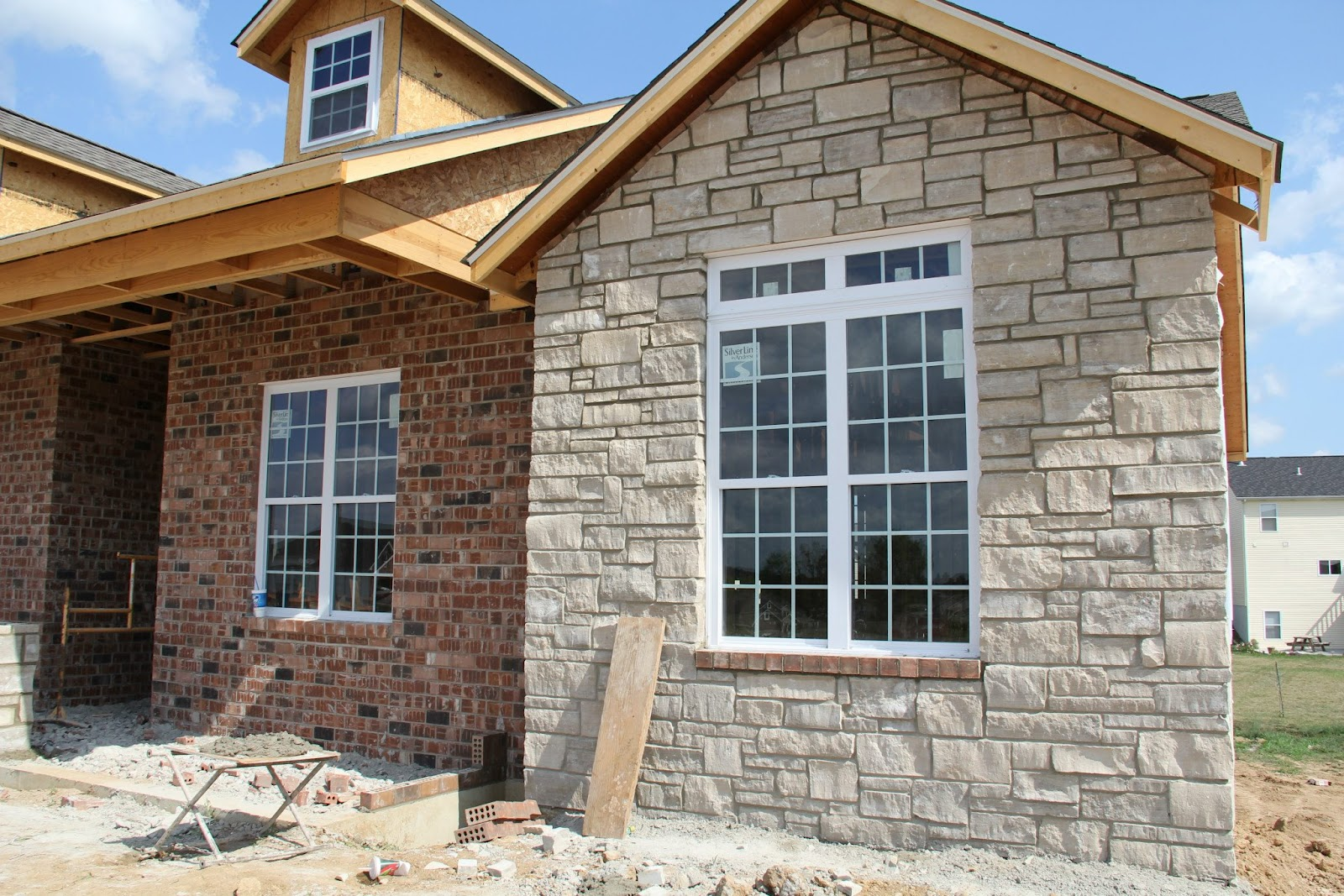 Our new home the exterior brick stone and siding for Brick and stone veneer