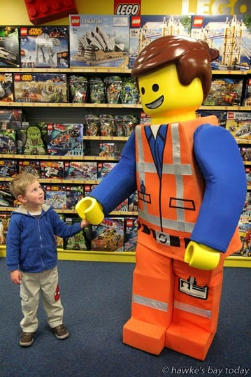"Zac Robinson,4, Napier, with Emmett, star of ""The LEGO Movie"", who will make a guest appearance at a LEGO Day at Toyworld, Dickens St, Napier, an annual BIG event. photograph"
