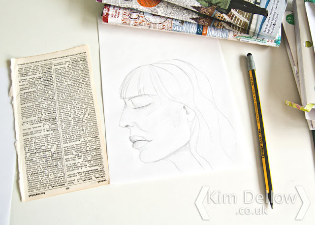 Pencil sketch of a face on layout paper