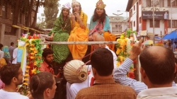 A video from The Kashmir Monitor shows the group chanting Hare Krishna in loud speakers and dancing on the streets. Three girls dressed as Krishna and his two wives are on the top of a truck that is colourfully decked up.