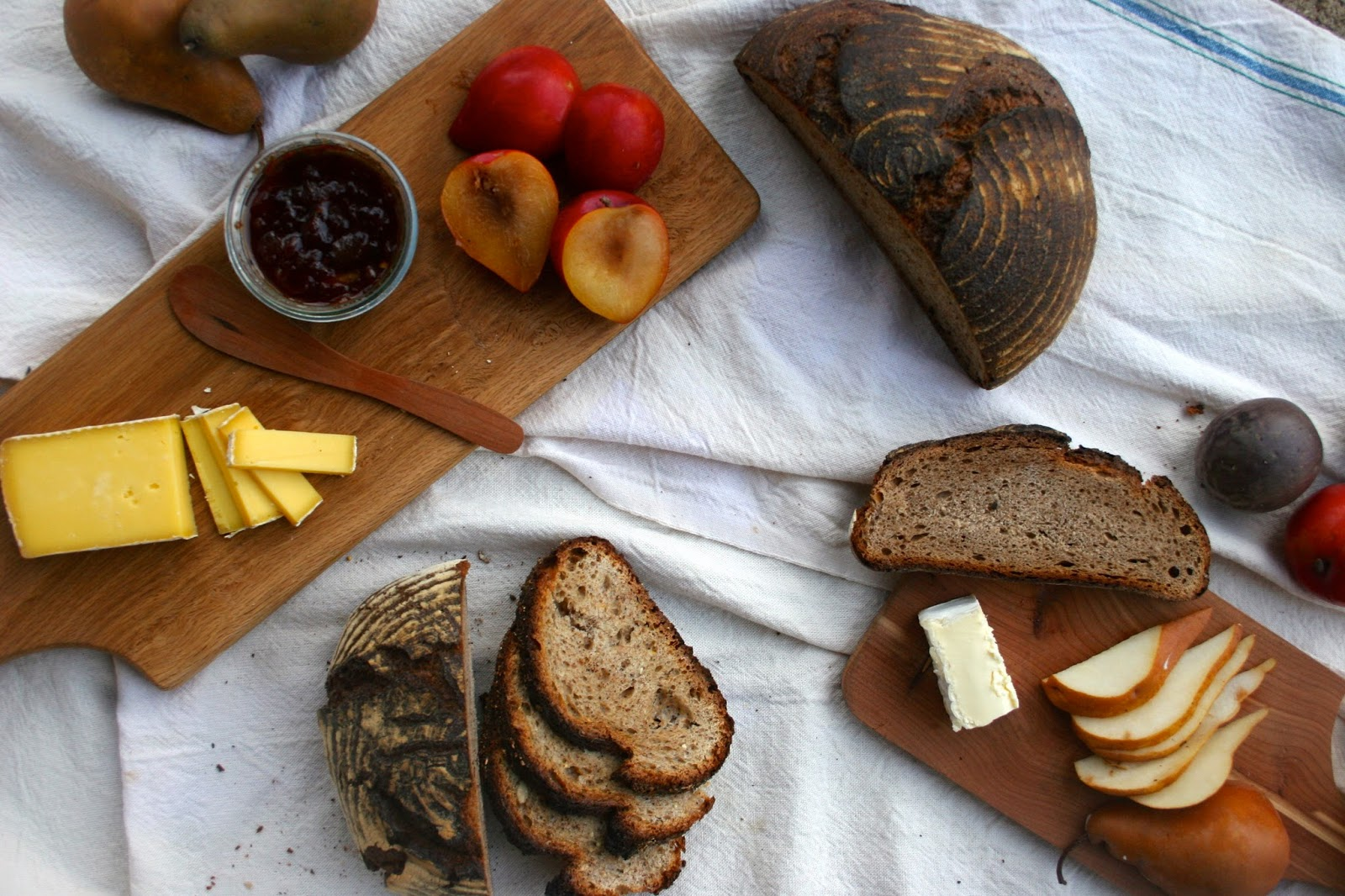 Cheese Place with Whole Grain Bread, Pears, and Plums