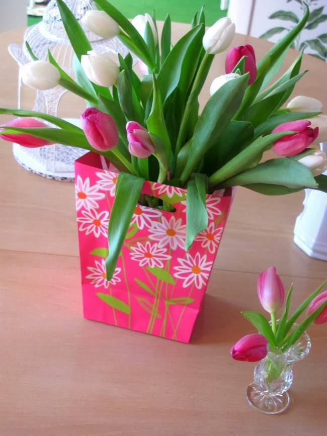 Using a gift back as a beautiful vase.