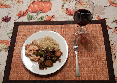 A meal of salmon, quinoa and sauteed brussel sprouts