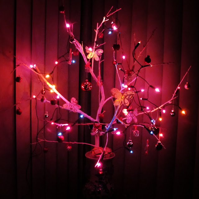 (Lights and Reds} Homemade DIY twig natural christmas tree on petiteplayground.blogspot.com