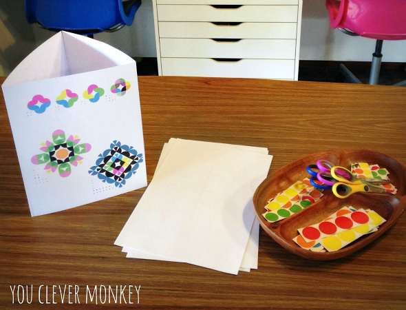 Symmetrical sticker pictures - an invitation to make symmetrical pictures from stickers using Ed Emberley's Picture Pie book as inspiration | you clever monkey