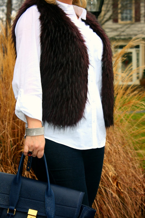Kenneth Cole faux fur vest, Blue skinny jeans from Rich & Skinny, White Button Down Shirt from Loft,  Aldo Peak Pumps, 3.1 Phillip Lim Pashli Satchel, Ray Ban Aviator Sunglasses, Michael Kors Oversized Madison Chronograph, Forever 21 beaded stretchy metallic bracelet