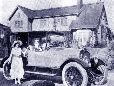 Mildred Chaplin (Charle's wife) at car after returning home from having a baby at the hospital.