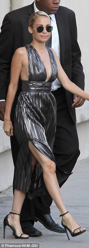 Nicole Richie flaunts side boob in a slinky silver dress in LA