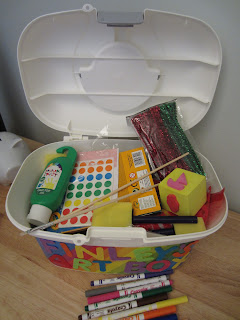 open art box overflowing with art supplies