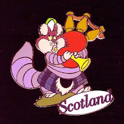 . pin of the Cheshire Cat in full Scots regalia, complete with bagpipe.