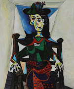. holding a pipe in his left hand. 5. Dora Maar with Cat by Pablo Picasso .