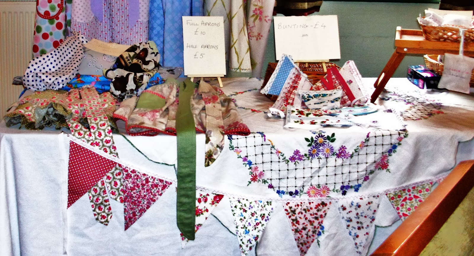 Table display of sewn items for sale in aid of Macmillan Cancer Support