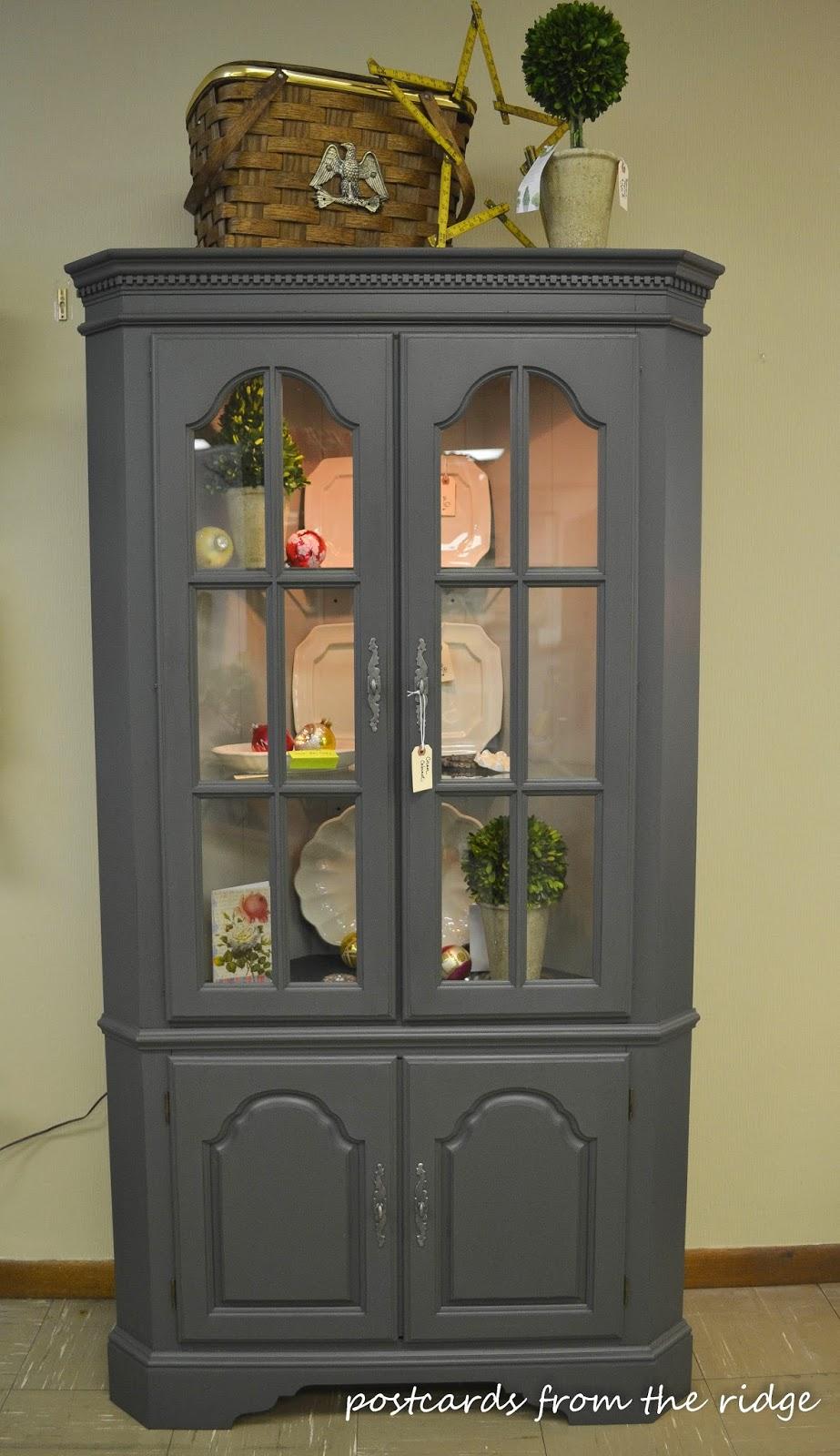 Corner cabinet painted in Benjamin Moore Ashwood Moss  #paintedfurniture #cornercabinet #benjaminmoore #ashwoodmoss