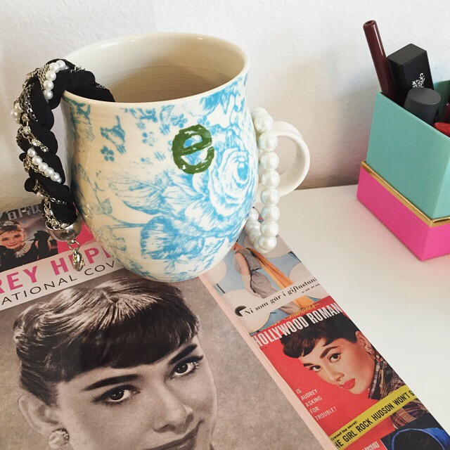 anthropologie coffee mug and audrey hepburn book