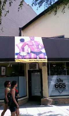 Naughty and fun Boy Butter banner proudly adorns top WeHo leather shop along LA's Gay Parade route