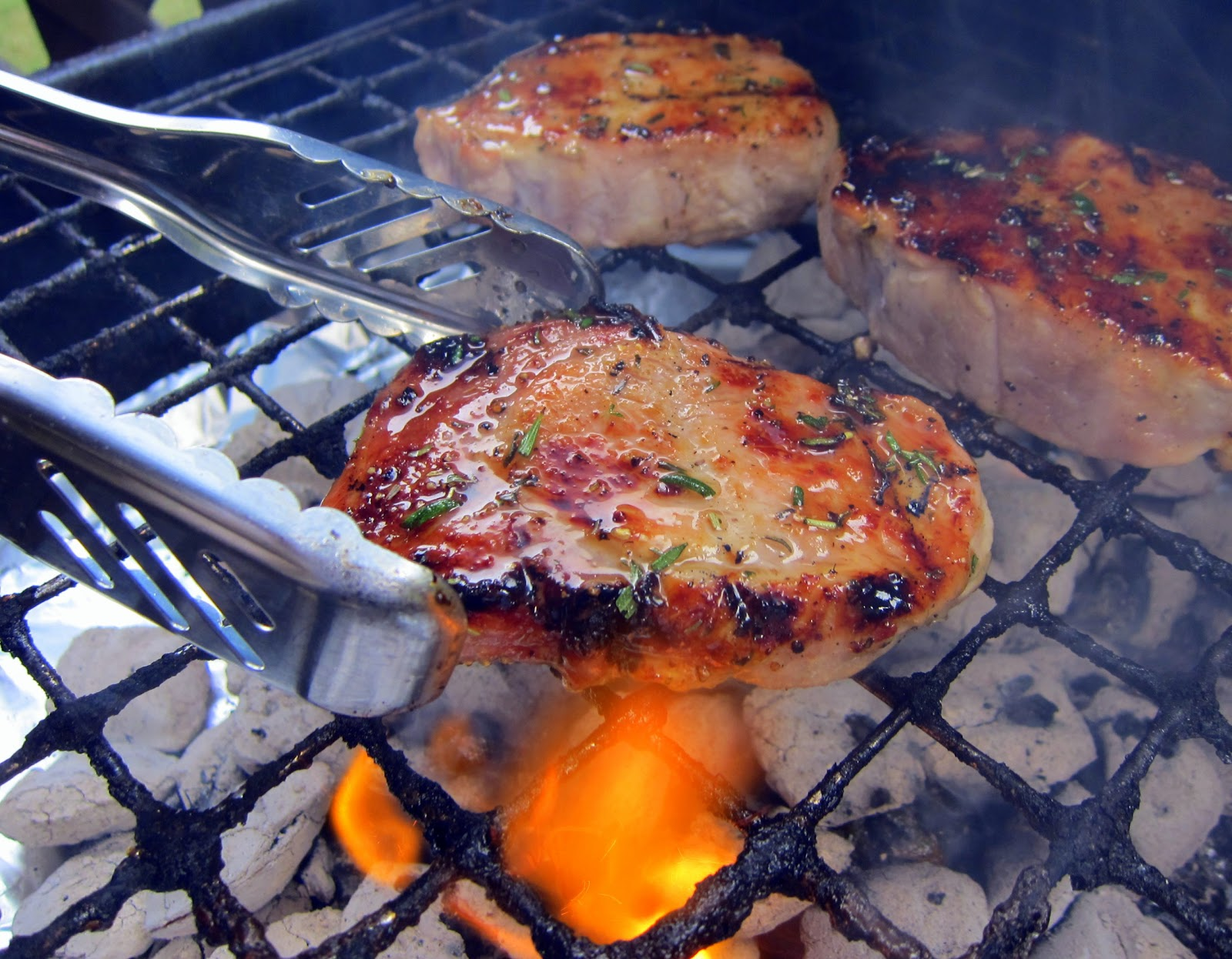 Simply grilling honey rosemary pork chops plain chicken honey rosemary grilled pork chops pork brushed with honey olive oil and fresh ccuart Image collections