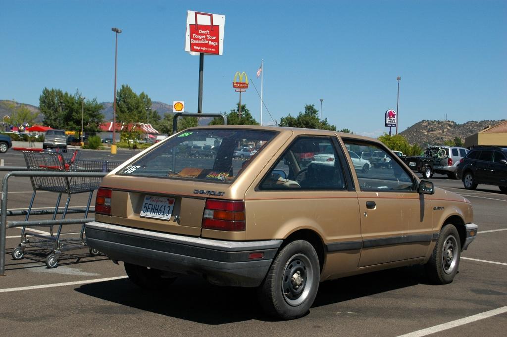 September 8 2011 & OLD PARKED CARS.: 1986 Chevrolet Spectrum 2-door hatchback.