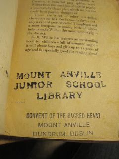 "Stamp on inside front page saying ""Mount Anville Junior School Library"""