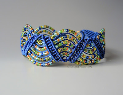 Micro macrame bracelet in Egyptian colors by Sherri Stokey.